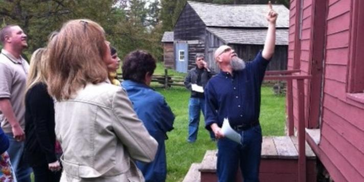 Class examines the exterior of an historic building at Sharon Temple National Historic Site