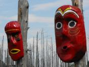 Masks hanging outside the Ouendat village at Huronia Museum.