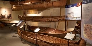 Image of the Origins Gallery with birchbark canoes
