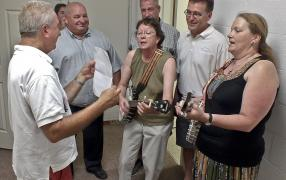Museum supporters and local politicians enjoy a song to open the new accessible washroom.