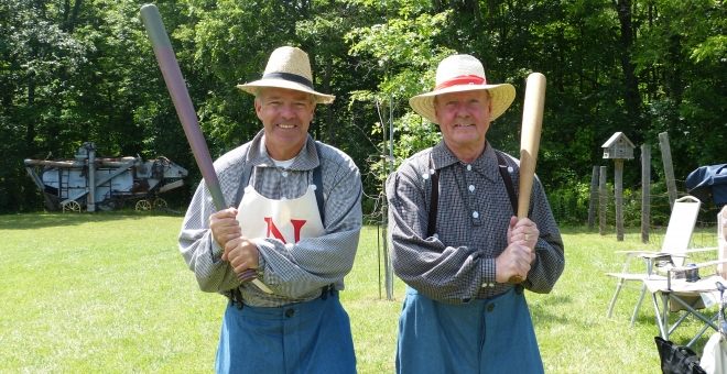 Two vintage base ball players with bats