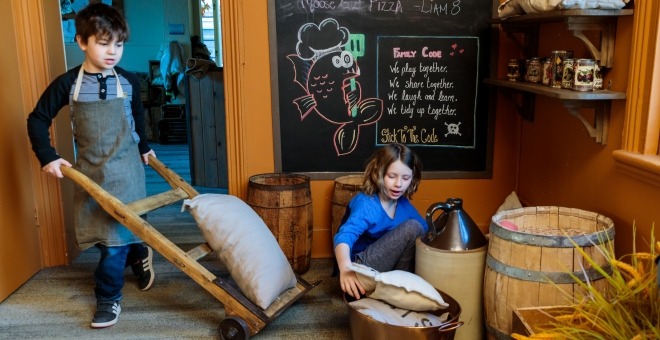 children playing the ship's kitchen themed gallery
