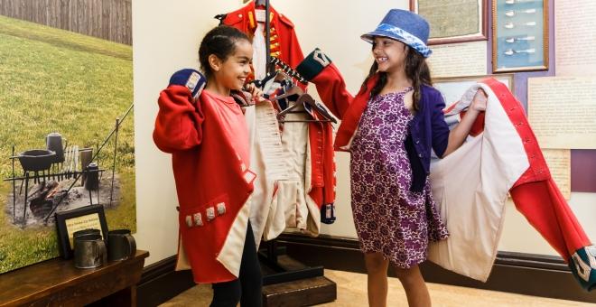 Children playing dress-up in War of 1812 Uniforms