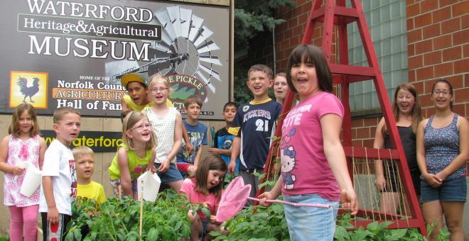 Children gardening in front of WHAM
