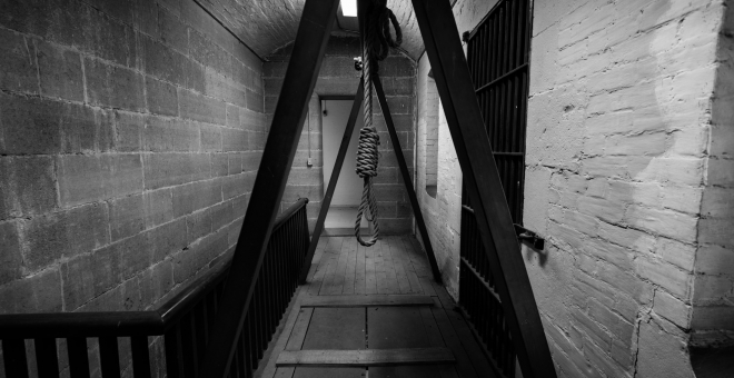 a black and white photo of the gallows showcased on the tour